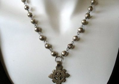 Pearls with hand-made pendant